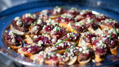 Catering image of crostinis with cheese and other toppings