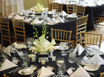 Formal table setting with napkins and floral arrangements