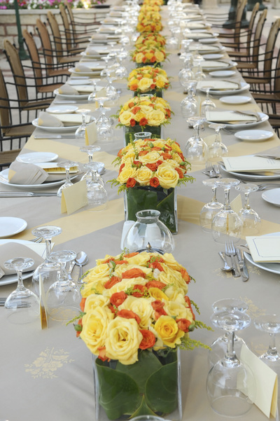 Formal table setting with plates and floral arrangement